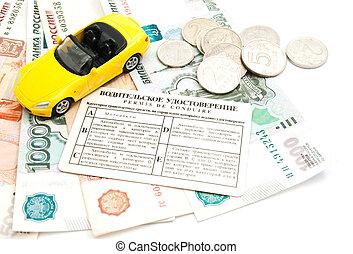 yellow car, driving license and banknotes