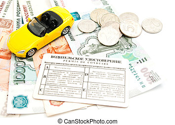 yellow car, driving license and money