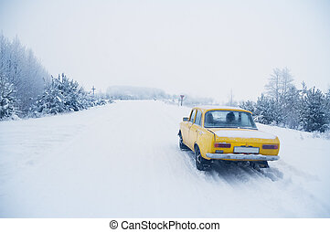 car on snow-covered winter road