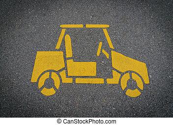 Yellow car sign on lanes asphalt road.