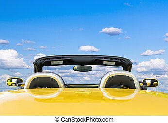 Yellow car with blue sky background