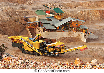 yellow career excavator in a quarry