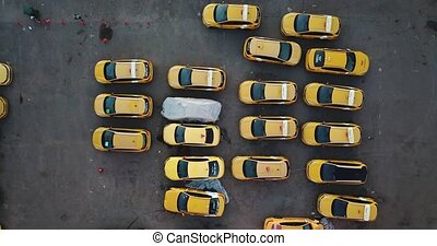 Aerial view of yellow cars parked in parking lot. High quality 4k footage