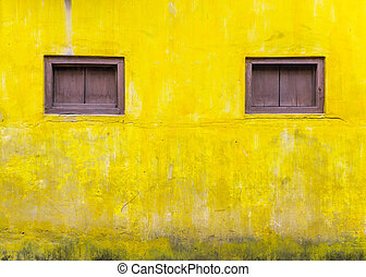 Yellow cement walll with Dark brown windows frame