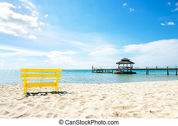 Yellow chair and blue sky  at sea, Complimentary color