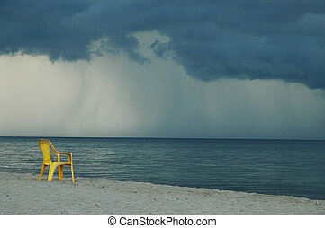 Yellow chair on the beach