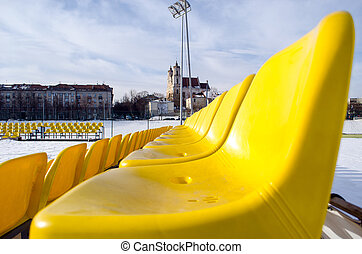yellow chairs row volleyball court in winter