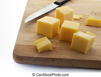 cheese on cutting board with knife