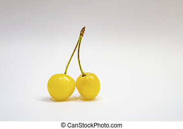 yellow cherry on a white background