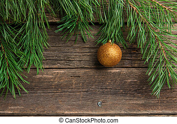 Yellow Christmas ball on wooden background