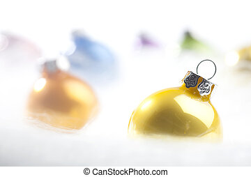 Yellow Christmas bauble in decorative snow