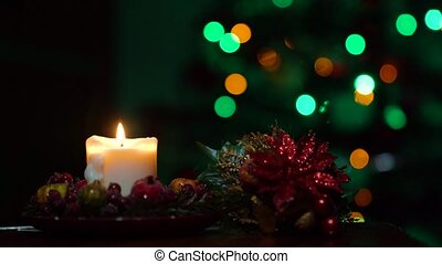 Yellow christmas candles on christmas tree background in darkness