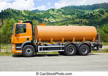 yellow cistern truck on the road