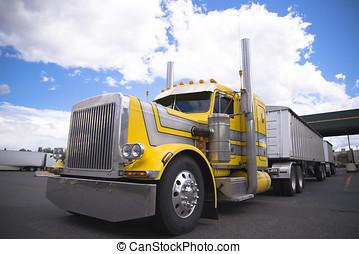Yellow classic custom semi truck with two bulk trailers -...