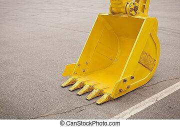 yellow clear excavator bucket