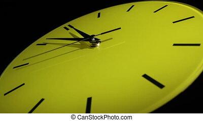 Yellow clock. Slow time lapse.