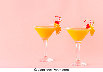 Yellow cocktail on a bright background.