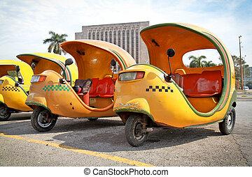 HAVANA-FEBRUARY 2: Yellow coco taxi on Revolucion plaza on February 2, 2010 in Havana, Cuba