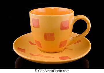 coffee cup over a black background