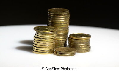 Yellow coin piles on black backgrou