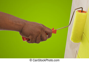 Yellow color painting wall with roller