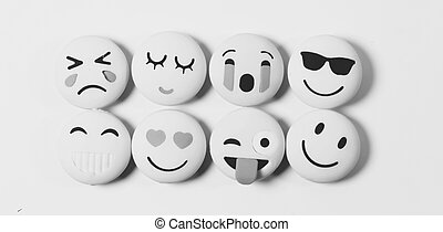 Yellow color various emotions emoji on a black and white background with selected focus on object .