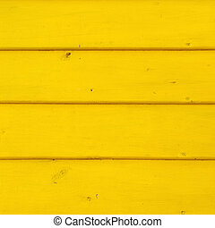 Yellow colored wooden boards. Vibrant color. Texture.