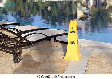 Yellow column near the pool, warns of danger
