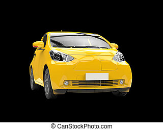 Yellow compact urban car on black background - closeup shot