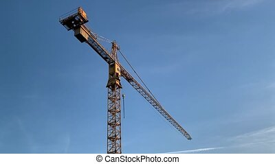 Yellow construction crane - High tower yellow construction...