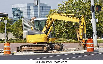 Yellow Construction Equipment on Street Corner