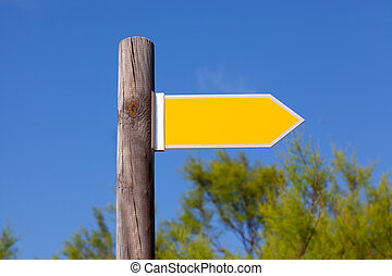 yellow copyspace arrow sign on wooden pole