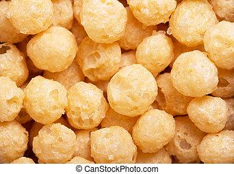 Yellow corn flour balls close-up texture. Light food.