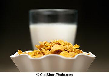 Yellow cornflakes and milk glass