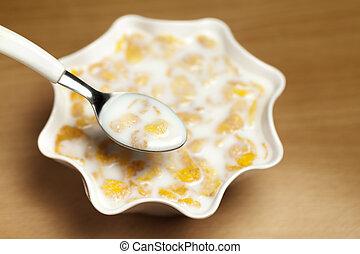 Yellow cornflakes with milk