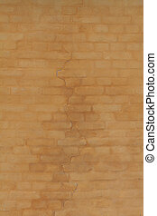 Yellow cracked brick wall