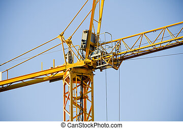 Yellow Crane against Blue Sky