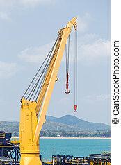 Yellow crane on a blue sky.