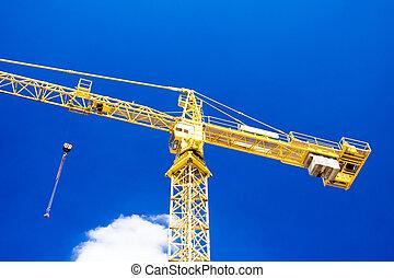 Yellow crane over blue sky