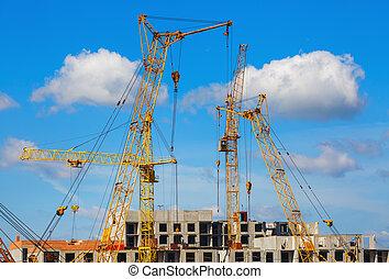 Yellow cranes, building