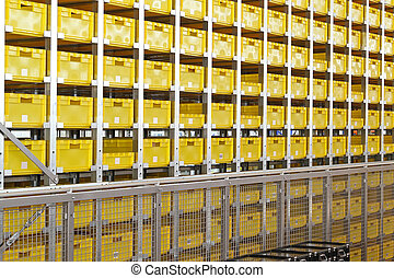 Yellow plastic crates at shelves in warehouse