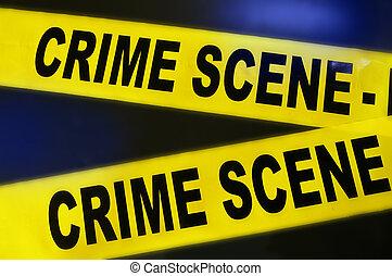 yellow crime scene tape on dark background