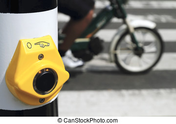 Yellow crosswalk button with scooter