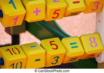 Yellow cubes with numbers and letters for children