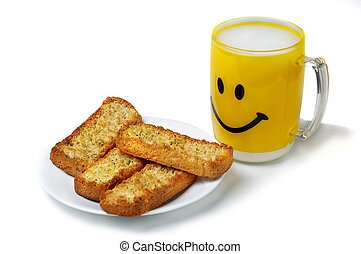 Yellow cup of milk with cracker. - Yellow cup of milk and...