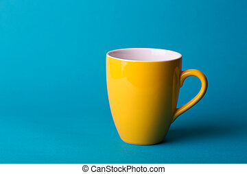 yellow cup on a blue background