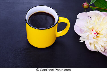 Yellow cup with black coffee