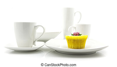 Yellow cupcake in white kitchen setting
