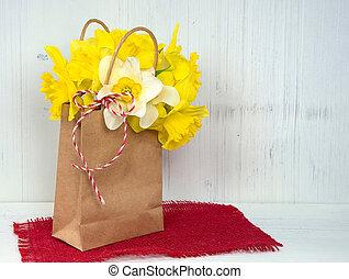 yellow daffodils in brown sack