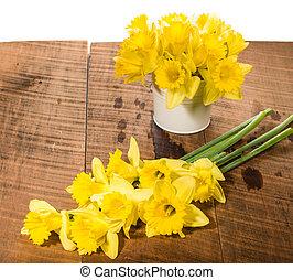 Yellow daffodils with metal vase